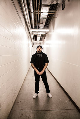 Taleb stands in the back hallway behind the salon where he goes to escape from the world. Photo by Dayla Brown
